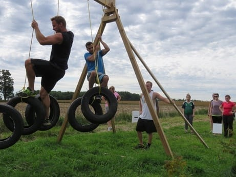 Skyliners try out the swinging tire obstacle