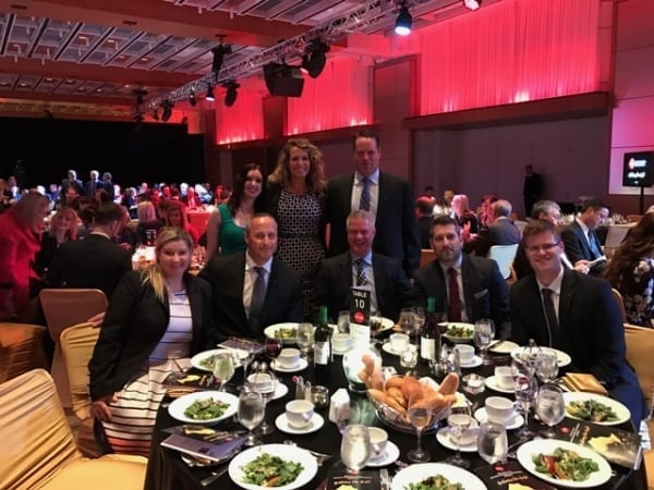 Executives attend the black tie dinner