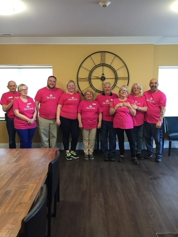 Nine Skyline staff in Ontario wear pink shirts