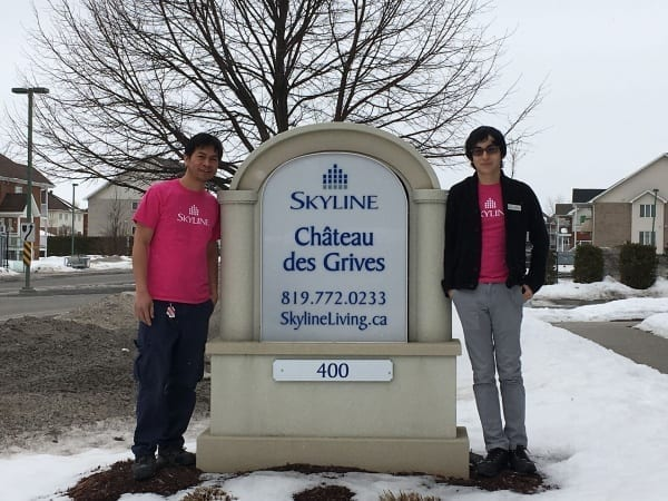 Two Skyline staff in Quebec wear pink shirts