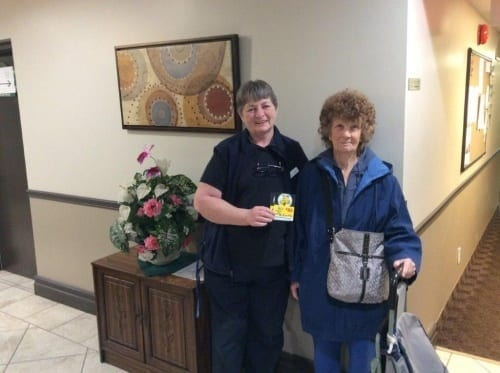 Connie donates a gift card to a resident in need