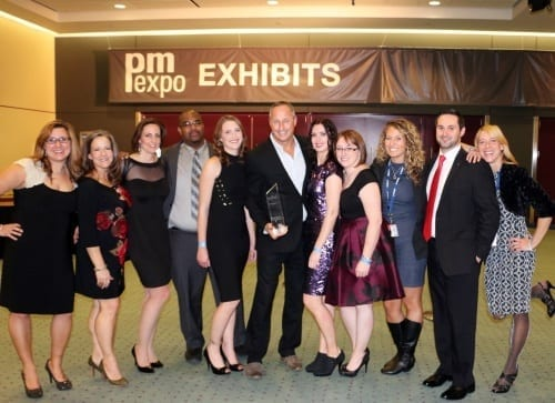 Eleven executives pose with the FRPO Award they won
